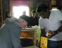 Lorne selling honey at Fanshawe Pioneer Village