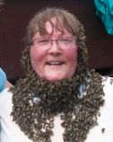 Barb wearing a beard of bees