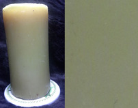 beeswax candle with bloom rubbed off